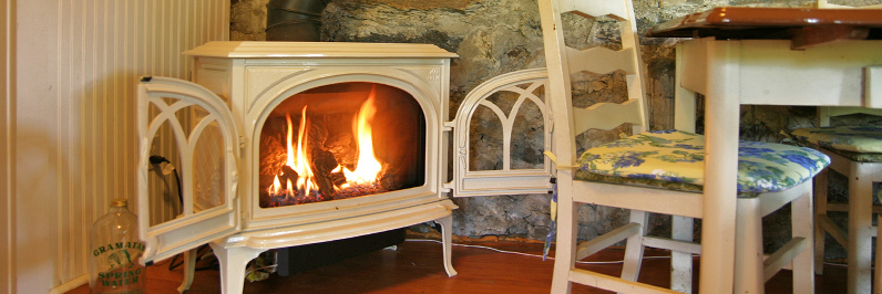 gas burning stove in cottage kitchen on lake near new fairfield, ct